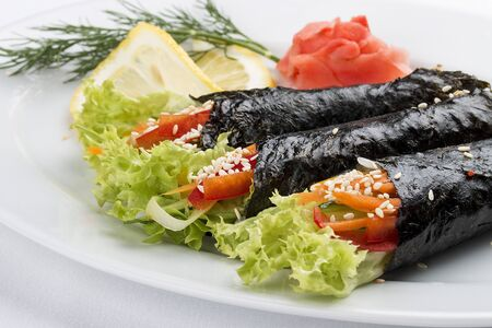 Temaki with vegetables on white background. Rolls in nori with a filling 스톡 콘텐츠 - 131604154
