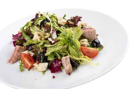 Salad with fried tuna and artichokes. On white background