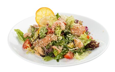 Salad with salmon and seafood. On a white background