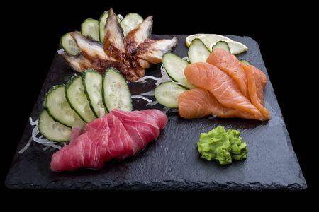 Sashimi set: eel, salmon, tuna. On dark background 스톡 콘텐츠 - 131599597