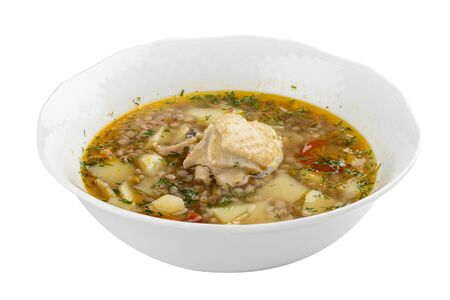 Chicken soup with buckwheat groats. On a white background