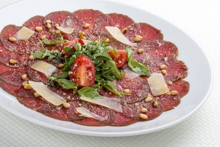 Tuna carpaccio with Parmesan cheese.  On white background Stock fotó
