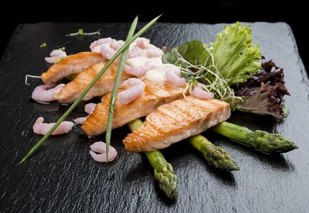 Roasted salmon on asparagus with mini-shrimps