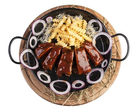 Barbecue pork ribs with fried potatoes. Top view on white background