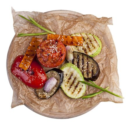 Grilled vegetables on parchment. On white background