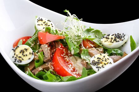 Salad with arugula and beef tongue, with tomatoes and egg 스톡 콘텐츠