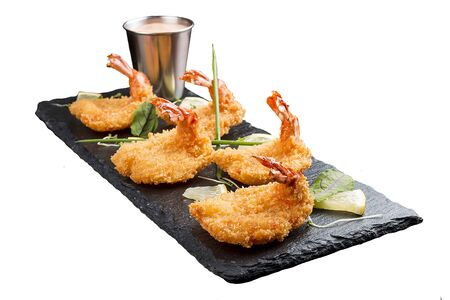 Tiger prawns in batter. Ebi tempura with spicy sauce on white background