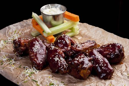 Chicken wings with sauce and vegetable snack