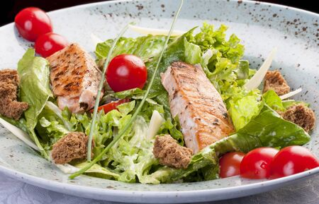 Caesar salad with salmon. 스톡 콘텐츠