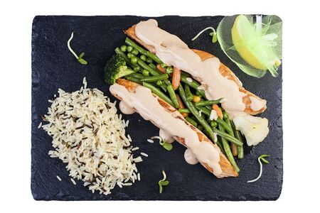 Salmon steak with wild rice and blanched vegetables