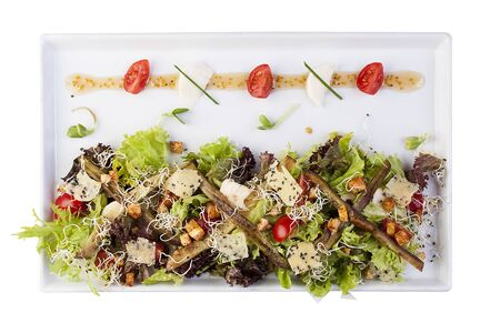 Salad with baked eggplants and mozzarella. On a white background