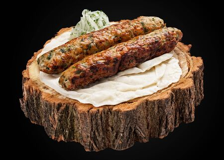 Kebab of chicken on a wooden slice