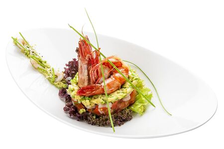 Salad with Royal shrimps and avocado on white background