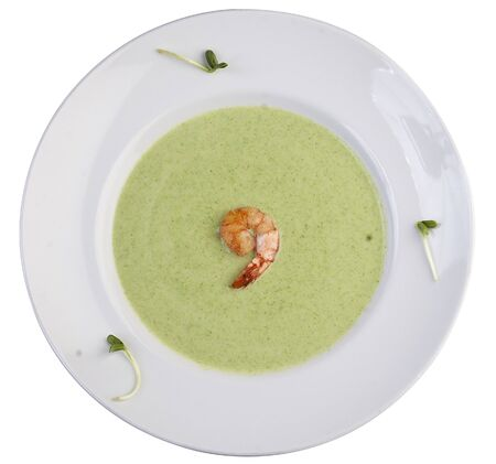 Cream soup with broccoli. Top view on white background