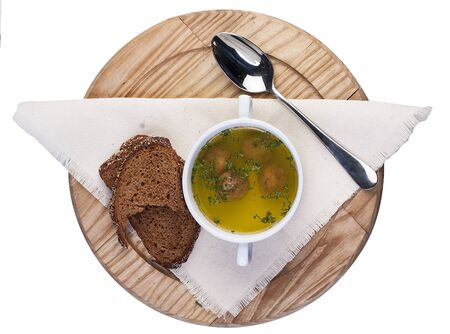Soup with meatballs pike. On a wooden Board.Yu top View on white background 스톡 콘텐츠