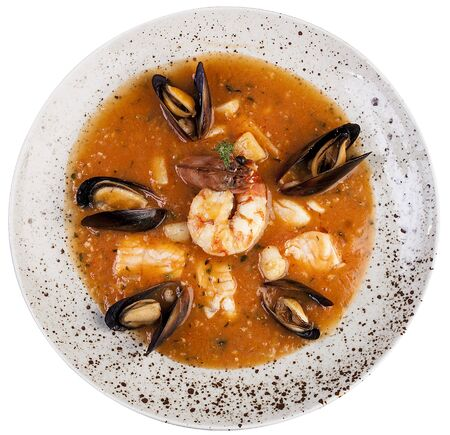 Bouillabaisse. Traditional French fish soup. Top view on white background.