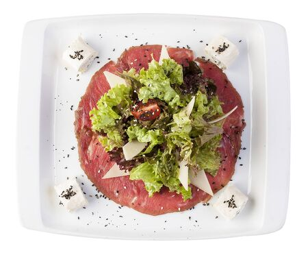 Mix salads on meat carpaccio with Philadelphia cheese. On a white background 스톡 콘텐츠