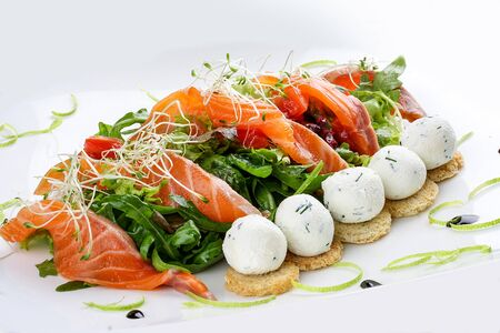 The salad with salmon and cottage cheese balls on a white background 스톡 콘텐츠