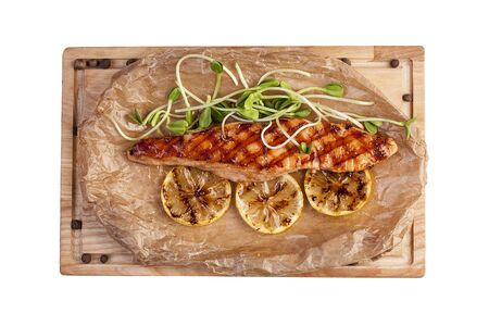 Fried salmon fillet on parchment 스톡 콘텐츠