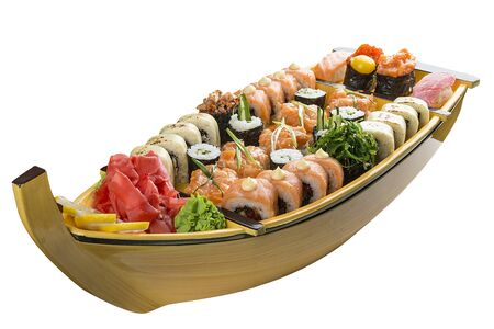 Sushi set in a wooden boat on a white background