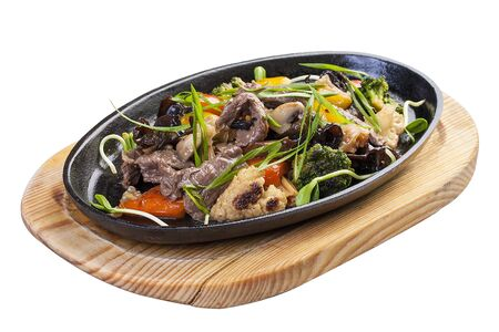 Hot frying pan with veal, chinese mushrooms and vegetables.