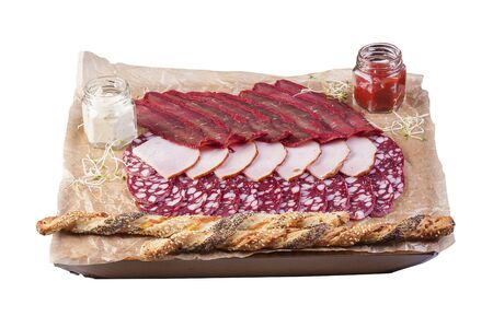 A set of meat snacks on a wooden Board. Ham, salami, basturma 스톡 콘텐츠