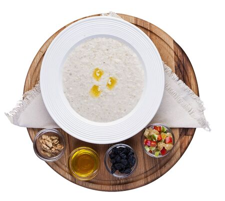 Oatmeal with candied fruits and raisins. Top view on white background 스톡 콘텐츠