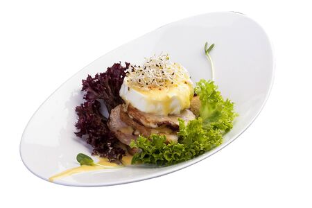 Breakfast. Benedictine eggs with salads on toast. On white background