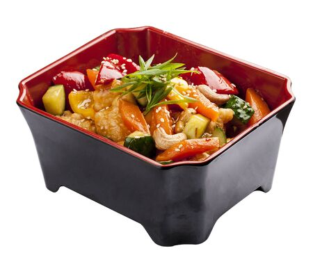 Kung Pao Chicken. Chicken pieces and vegetables fried in sweet and sour sauce. In the black box on a white background 스톡 콘텐츠