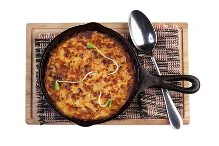 Lasagna in a cast iron pan. The view from the top. On white background 스톡 콘텐츠