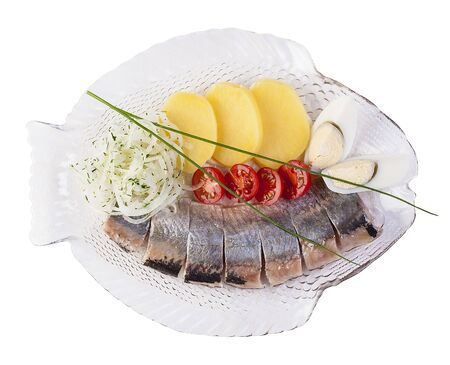 Herring with boiled potatoes and onion. On white background 스톡 콘텐츠