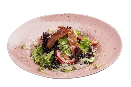Salad with smoked chicken and Radomer cheese. On white background