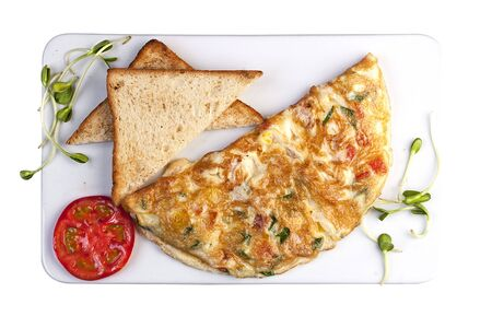 Omelette with ham and cheese. Top view on white background
