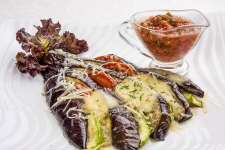 Grilled vegetables with spicy sauce on white background 스톡 콘텐츠