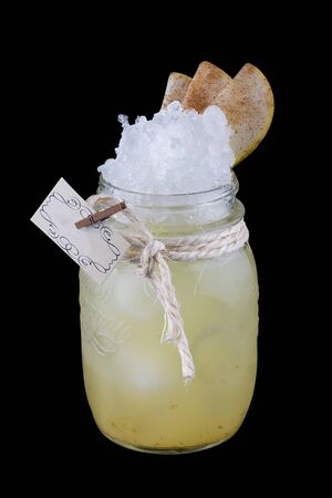 Apple lemonade with cinnamon in a glass jar on a dark background