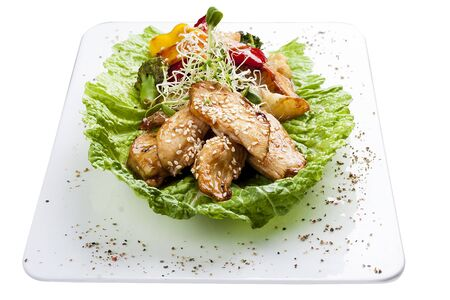 Chicken fillet with vegetables in soy-garlic sauce. On white background 스톡 콘텐츠