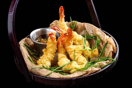 Tiger prawns in batter. Ebi tempura on dark background 스톡 콘텐츠