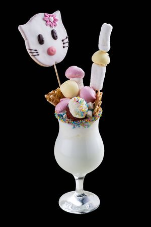 Milk shake with sweets on dark background 스톡 콘텐츠