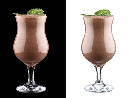 Fruit and chocolate smoothie on dark and white background