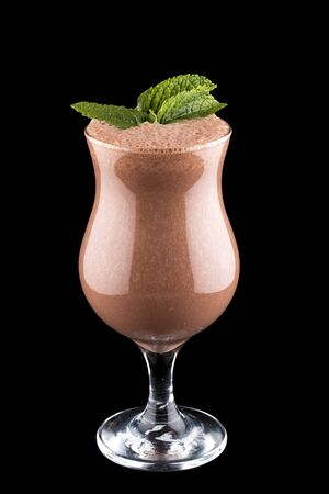 Fruit and chocolate smoothie on dark  background