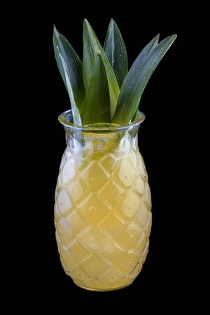 Pineapple lemonade on dark background