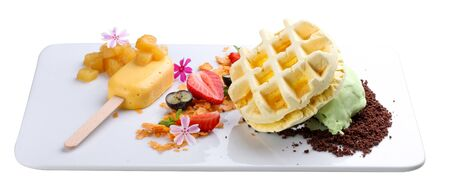 Dessert with waffle and creme brulee on a white background