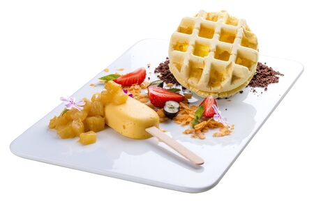 Dessert with waffle and creme brulee on a white background Banco de Imagens