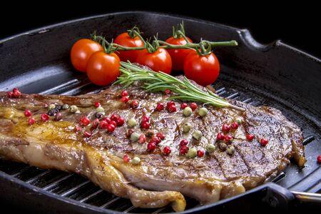 Cowboy beef steak in a cast iron pan