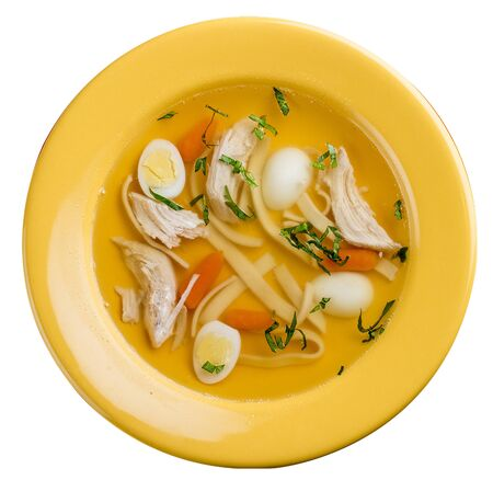 Chicken broth with egg in a colored plate. Meals for children. Фото со стока