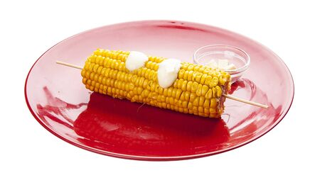 Corn on the cob with butter. Meals for children.