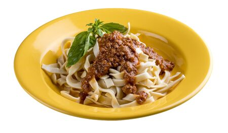 Pasta Bolognese in a bright plate. Italian traditional dish. Meals for children. Фото со стока