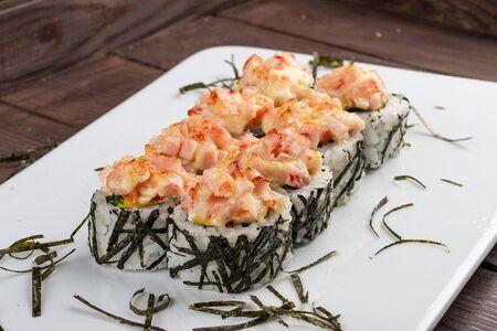 Spicy sushi rolls in nori on white background Stok Fotoğraf - 137894573