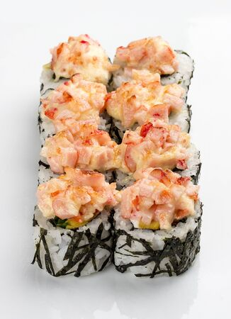 Spicy sushi rolls in nori on white background Stok Fotoğraf - 137894441