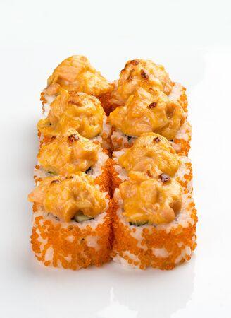 Spicy sushi roll in tobiko on white background 版權商用圖片